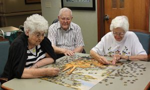 Willow Brook Residents putting together a puzzle
